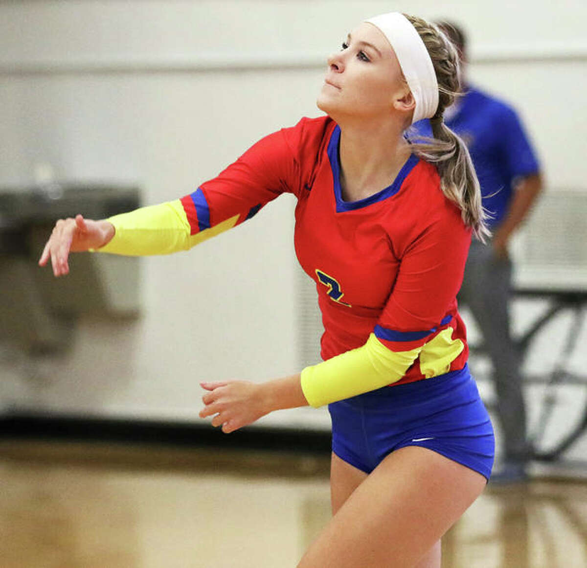 Roxana's Reagen Stahlhut watches her serve clear the net during a 2019 match at Milazzo Gym in Roxana. Starting in 2021, Shells volleyball will find challenges within the Cahokia Conference where traditional powers Breese Central, Columbia and Freeburg compete.