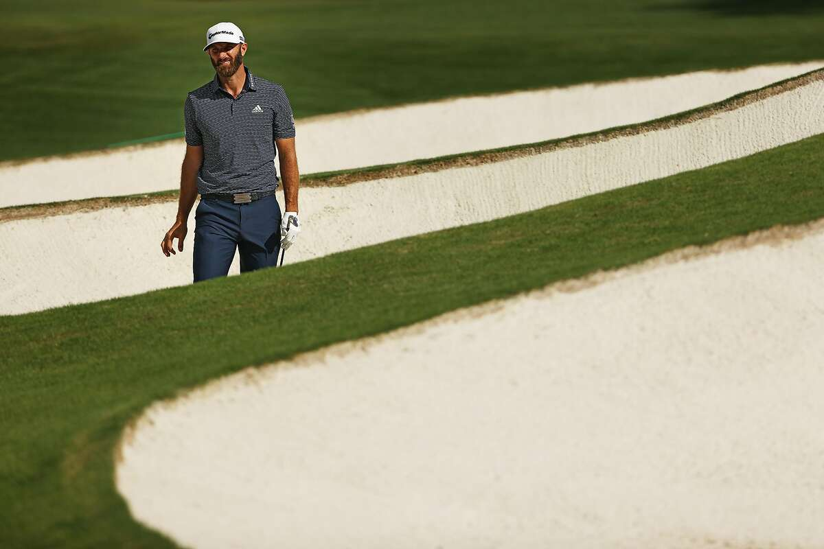 AUGUSTA, GEORGIA - NOVEMBER 15: Dustin Johnson of the United States reacts after playing a shot from a bunker on the seventh hole during the final round of the Masters at Augusta National Golf Club on November 15, 2020 in Augusta, Georgia. (Photo by Patrick Smith/Getty Images)