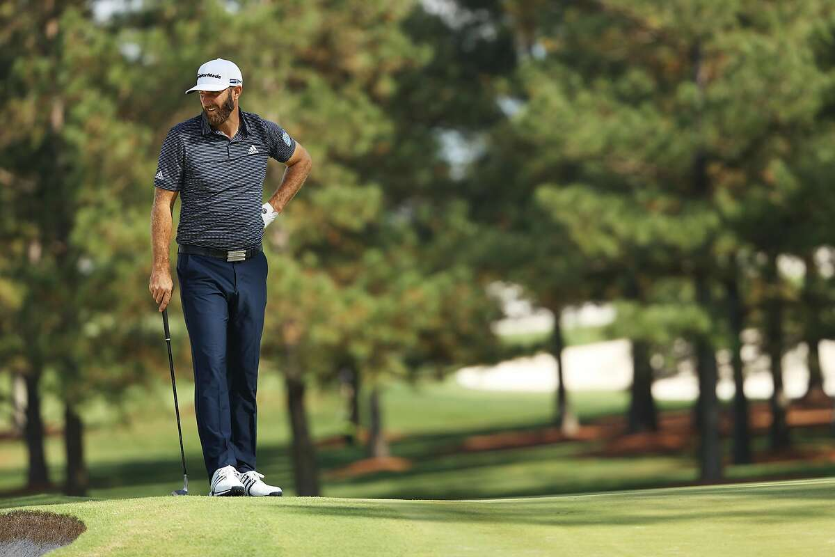 AUGUSTA, GEORGIA - NOVEMBER 15: Dustin Johnson of the United States stands on the seventh green during the final round of the Masters at Augusta National Golf Club on November 15, 2020 in Augusta, Georgia. (Photo by Patrick Smith/Getty Images)