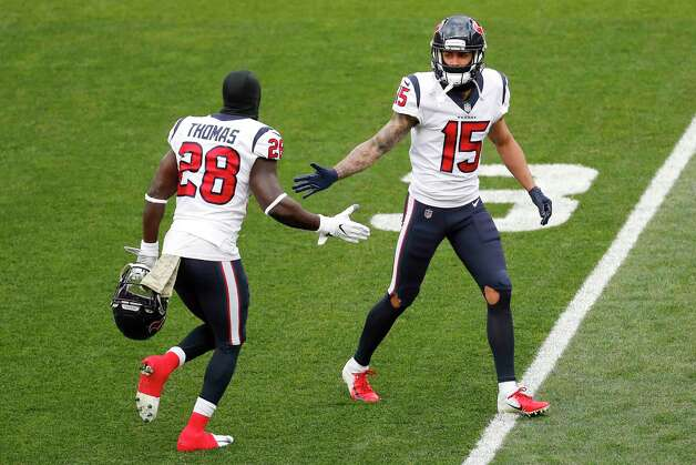 Houston Texans defensive back Michael Thomas (28) and wide receiver Will Fuller (15) high five while warming up during the first half of an NFL football game at FirstEnergy Stadium Sunday, Nov. 15, 2020, in Cleveland. Photo: Brett Coomer, Staff Photographer / © 2020 Houston Chronicle
