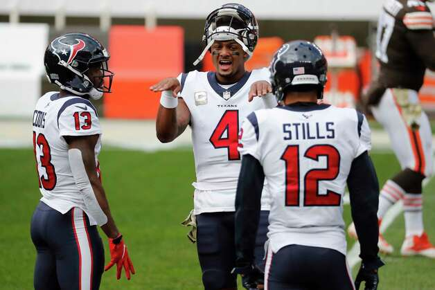 Houston Texans quarterback Deshaun Watson (4) talks to wide receivers Brandin Cooks (13) and Kenny Stills (12) as they warm. up before an NFL football game against the Cleveland Browns at FirstEnergy Stadium Sunday, Nov. 15, 2020, in Cleveland. Photo: Brett Coomer, Staff Photographer / © 2020 Houston Chronicle