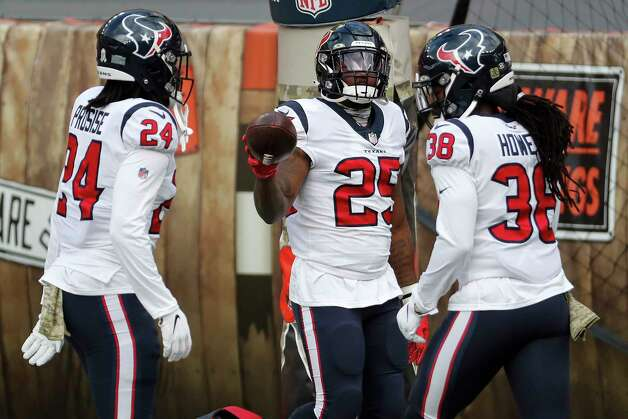 Houston Texans running backs C.J. Prosise (24), Duke Johnson (25) and Buddy Howell (38) warm up before an NFL football game against the Cleveland Browns at FirstEnergy Stadium Sunday, Nov. 15, 2020, in Cleveland. Photo: Brett Coomer, Staff Photographer / © 2020 Houston Chronicle