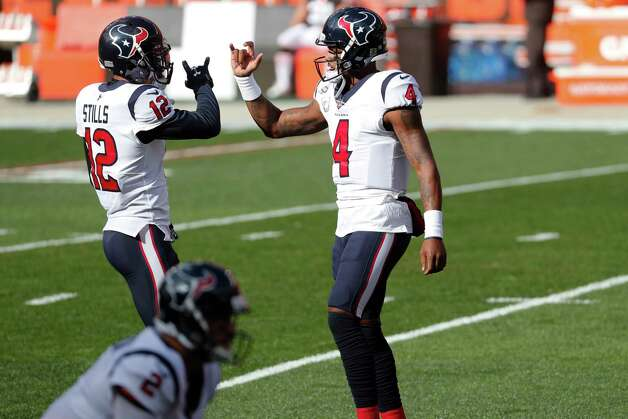 Houston Texans wide receiver Kenny Stills (12) and. quarterback Deshaun Watson high five as Stills runs onto the field before an NFL football game against the Cleveland Browns at FirstEnergy Stadium Sunday, Nov. 15, 2020, in Cleveland. Photo: Brett Coomer, Staff Photographer / © 2020 Houston Chronicle