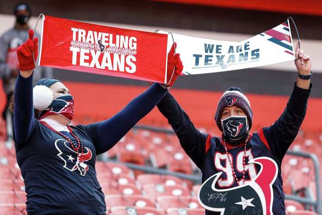 Houston Texans fans cheer as they watch warm ups before an NFL football game against the Cleveland Browns at FirstEnergy Stadium Sunday, Nov. 15, 2020, in Cleveland. Photo: Brett Coomer, Staff Photographer / © 2020 Houston Chronicle