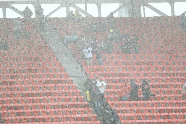 Fans stand in the rain during a heavy thunderstorm before the start of an NFL football game between the Houston Texans and the Cleveland Browns at FIrstEnergy Stadium Sunday, Nov. 15, 2020, in Cleveland. Players and fans were evacuated from the field due to a heavy thunderstorm. Photo: Brett Coomer, Staff Photographer / 2020 Houston Chronicle