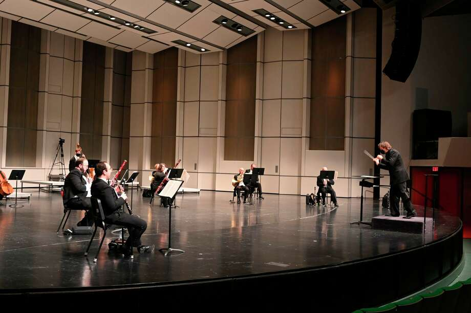 Members of the Midland Symphony Orchestra performed for a small live audience, while others watched as the concert was streamed online Saturday, Nov. 14 at the Midland Center for the Arts. (Adam Ferman/for the Daily News)