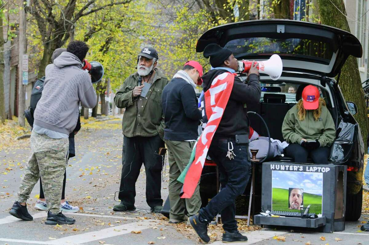 Supporters of President Donald Trump, background, and members of Black Lives Matter try to shout each other out near the Governor's mansion on Sunday, Nov. 15, 2020, in Albany, N.Y. Trump supporters held a caravan through the City of Albany, but police blocked off the roads around the Governor's mansion after a few President Trump supporters were able to park near the mansion. Members Black Lives Matter then showed up for a counter protest. (Paul Buckowski/Times Union)