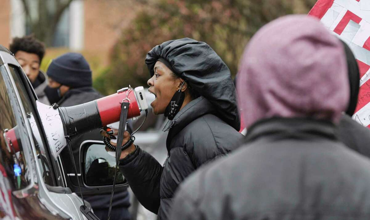 Members of Black Lives Matter yell at Albany Police Officers to get out after the Police showed up at a contentious gathering of Black Lives Matter members and supporters of President Donald Trump outside the Governor's mansion on on Sunday, Nov. 15, 2020, in Albany, N.Y. After Albany Police persuaded the small group of President Trump supporters to leave the area, members of Black Lives Matter began yelling at Albany Police to leave the area too. (Paul Buckowski/Times Union)