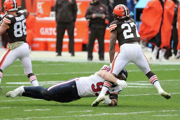 Houston Texans defensive end J.J. Watt (99) stops Cleveland Browns running back Kareem Hunt for a loss during the first half of an NFL football game at FIrstEnergy Stadium Sunday, Nov. 15, 2020, in Cleveland. Photo: Brett Coomer, Staff Photographer / 2020 Houston Chronicle