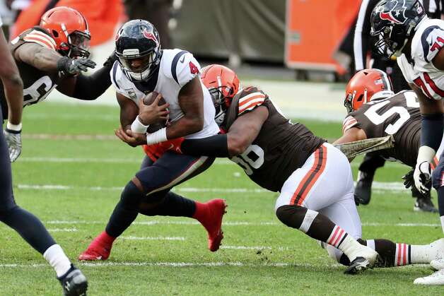 Houston Texans quarterback Deshaun Watson is sacked by the Cleveland Browns during the first half of an NFL football game at FIrstEnergy Stadium Sunday, Nov. 15, 2020, in Cleveland. Photo: Brett Coomer, Staff Photographer / 2020 Houston Chronicle