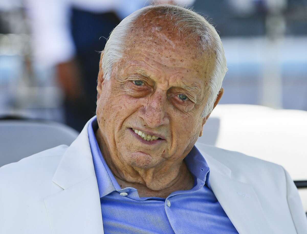 FILE - Los Angeles Dodgers former manager and Hall of Famer Tommy Lasorda attends a news conference where Baseball Commissioner Rob Manfred announced that Dodger Stadium will host the All-Star Game in 2020, in Los Angeles, in this Wednesday, April 11, 2018, file photo. The Dodgers said Sunday, Nov. 15, 2020, that their 93-year-old former manager was in intensive care and resting comfortably at a hospital in Orange County, Calif. (AP Photo/Damian Dovarganes)