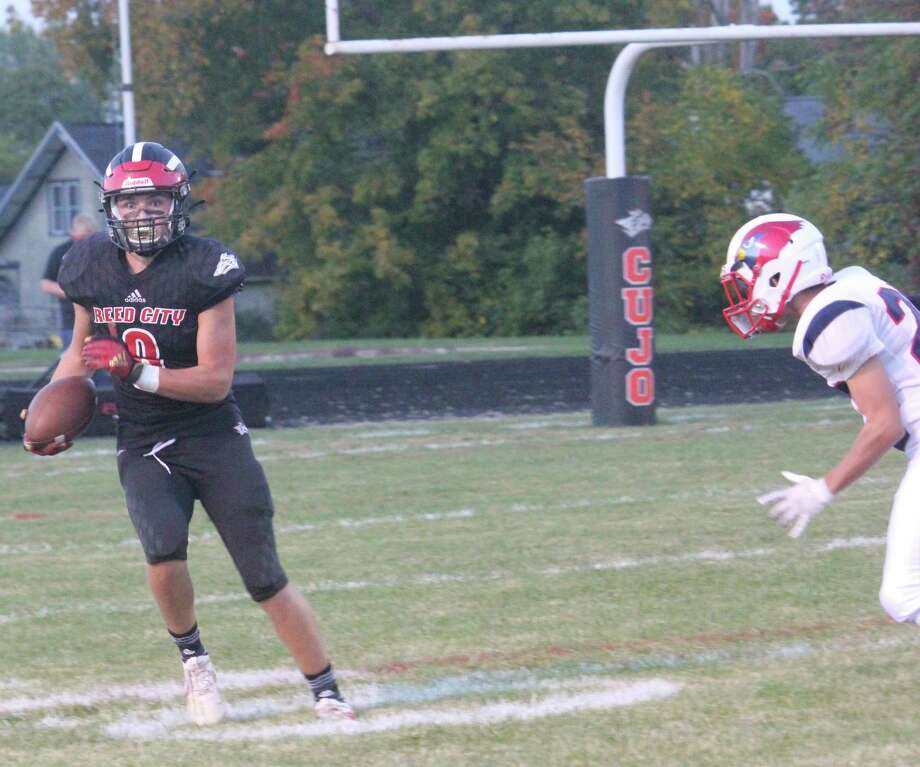 Reed City's Seth Jackson (left) is about to score after making a catch against Big Rapids earlier this season. (Pioneer file photo)