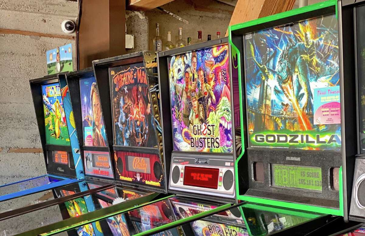 A line of pinball machines are seen at Coin-Op Game Room in San Francisco. The popular arcade bar has permanently closed.