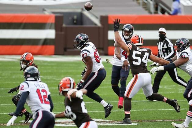 Houston Texans quarterback Deshaun Watson (4) passes over Cleveland Browns defensive end Olivier Vernon (54) during the first half of an NFL football game at FirstEnergy Stadium Sunday, Nov. 15, 2020, in Cleveland. Photo: Brett Coomer, Staff Photographer / © 2020 Houston Chronicle