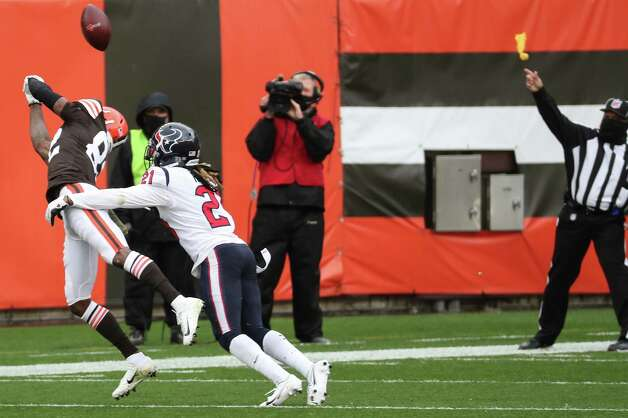 Houston Texans cornerback Bradley Roby (21) is called for pass interference as he breaks up a pass intended for Cleveland Browns wide receiver Rashard Higgins (82) during the first half of an NFL football game at FirstEnergy Stadium Sunday, Nov. 15, 2020, in Cleveland. Photo: Brett Coomer, Staff Photographer / © 2020 Houston Chronicle