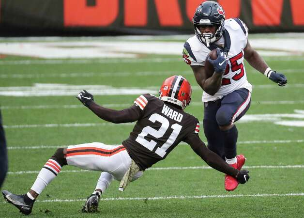 Houston Texans running back Duke Johnson (25) is tripped up by Cleveland Browns cornerback Denzel Ward (21) during the first half of an NFL football game at FirstEnergy Stadium Sunday, Nov. 15, 2020, in Cleveland. Photo: Brett Coomer, Staff Photographer / © 2020 Houston Chronicle