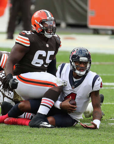 Cleveland Browns defensive tackle Larry Ogunjobi (65) celebrates after sacking Houston Texans quarterback Deshaun Watson (4) during the first half of an NFL football game at FirstEnergy Stadium Sunday, Nov. 15, 2020, in Cleveland. Photo: Brett Coomer, Staff Photographer / © 2020 Houston Chronicle