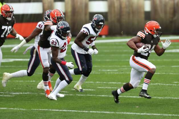Cleveland Browns running back Nick Chubb (24) runs past Houston Texans free safety Eric Murray (23) and linebacker Tyrell Adams (50) as he runs outside during the first half of an NFL football game at FirstEnergy Stadium Sunday, Nov. 15, 2020, in Cleveland. Photo: Brett Coomer, Staff Photographer / © 2020 Houston Chronicle