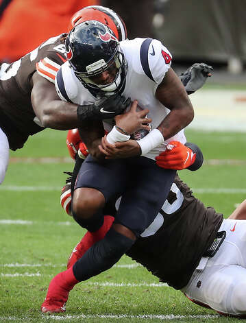Houston Texans quarterback Deshaun Watson (4) is sacked by Cleveland Browns defensive tackle Sheldon Richardson (98) and Larry Ogunjobi (65) during the first half of an NFL football game at FirstEnergy Stadium Sunday, Nov. 15, 2020, in Cleveland. Photo: Brett Coomer, Staff Photographer / © 2020 Houston Chronicle