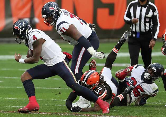 Houston Texans quarterback Deshaun Watson (4) breaks away from Cleveland Browns safety Sheldrick Redwine (29) and a potential sack  during the third quarter of an NFL football game at FirstEnergy Stadium Sunday, Nov. 15, 2020, in Cleveland. Photo: Brett Coomer, Staff Photographer / © 2020 Houston Chronicle