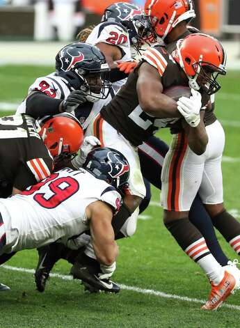 Cleveland Browns running back Nick Chubb (24) is brought down from behind by Houston Texans defensive end J.J. Watt (99) during the third quarter of an NFL football game at FirstEnergy Stadium Sunday, Nov. 15, 2020, in Cleveland. Photo: Brett Coomer, Staff Photographer / © 2020 Houston Chronicle