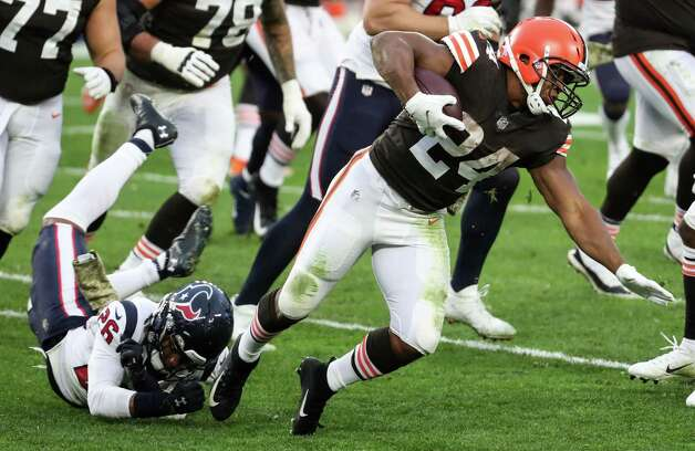 Cleveland Browns running back Nick Chubb (24) is tripped up by Houston Texans cornerback Vernon Hargreaves III (26) during the third quarter of an NFL football game at FirstEnergy Stadium Sunday, Nov. 15, 2020, in Cleveland. Photo: Brett Coomer, Staff Photographer / © 2020 Houston Chronicle