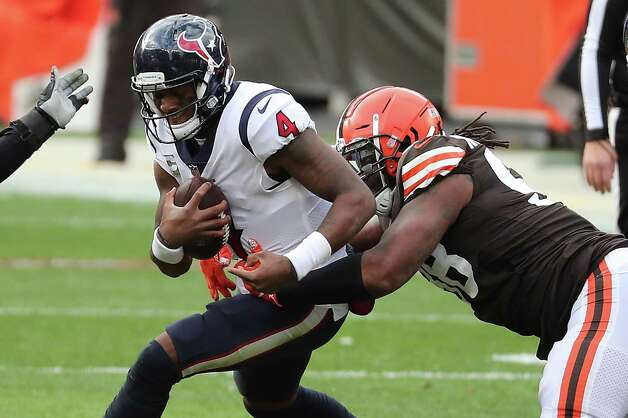 Houston Texans quarterback Deshaun Watson (4) is sacked by Cleveland Browns defensive tackle Sheldon Richardson (98) during the first half of an NFL football game at FirstEnergy Stadium Sunday, Nov. 15, 2020, in Cleveland. Photo: Brett Coomer, Staff Photographer / © 2020 Houston Chronicle