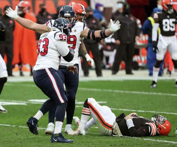 Houston Texans defensive end J.J. Watt (99) and defensive lineman Corey Liuget (93) celebrate after Liuget sacked Cleveland Browns quarterback Baker Mayfield (6) during the third quarter of an NFL football game at FirstEnergy Stadium Sunday, Nov. 15, 2020, in Cleveland. Photo: Brett Coomer, Staff Photographer / © 2020 Houston Chronicle
