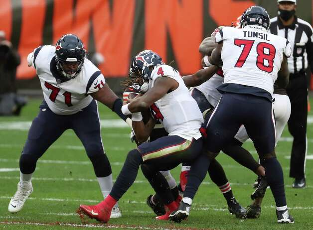 Houston Texans quarterback Deshaun Watson (4) is hit by Cleveland Browns safety Sheldrick Redwine (29) in the pocket during the third quarter of an NFL football game at FirstEnergy Stadium Sunday, Nov. 15, 2020, in Cleveland. Photo: Brett Coomer, Staff Photographer / © 2020 Houston Chronicle