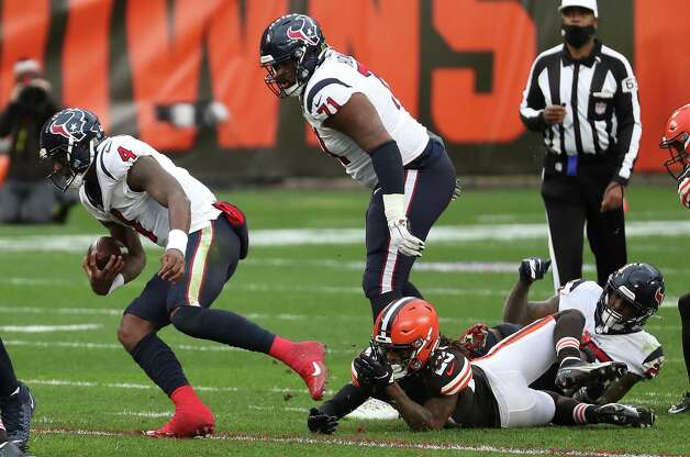 Houston Texans quarterback Deshaun Watson (4) breaks away from Cleveland Browns safety Sheldrick Redwine (29) as he is forced out of the pocket during the third quarter of an NFL football game at FirstEnergy Stadium Sunday, Nov. 15, 2020, in Cleveland. Photo: Brett Coomer, Staff Photographer / © 2020 Houston Chronicle