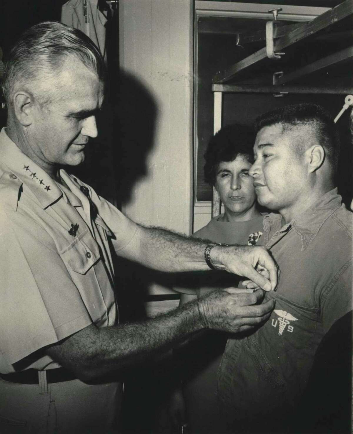 General William C. Westmoreland, Army Chief of Staff, former Commander of Allied Forces in Vietnam, pins Staff Sergeant Roy P. Benavidez at El Campo