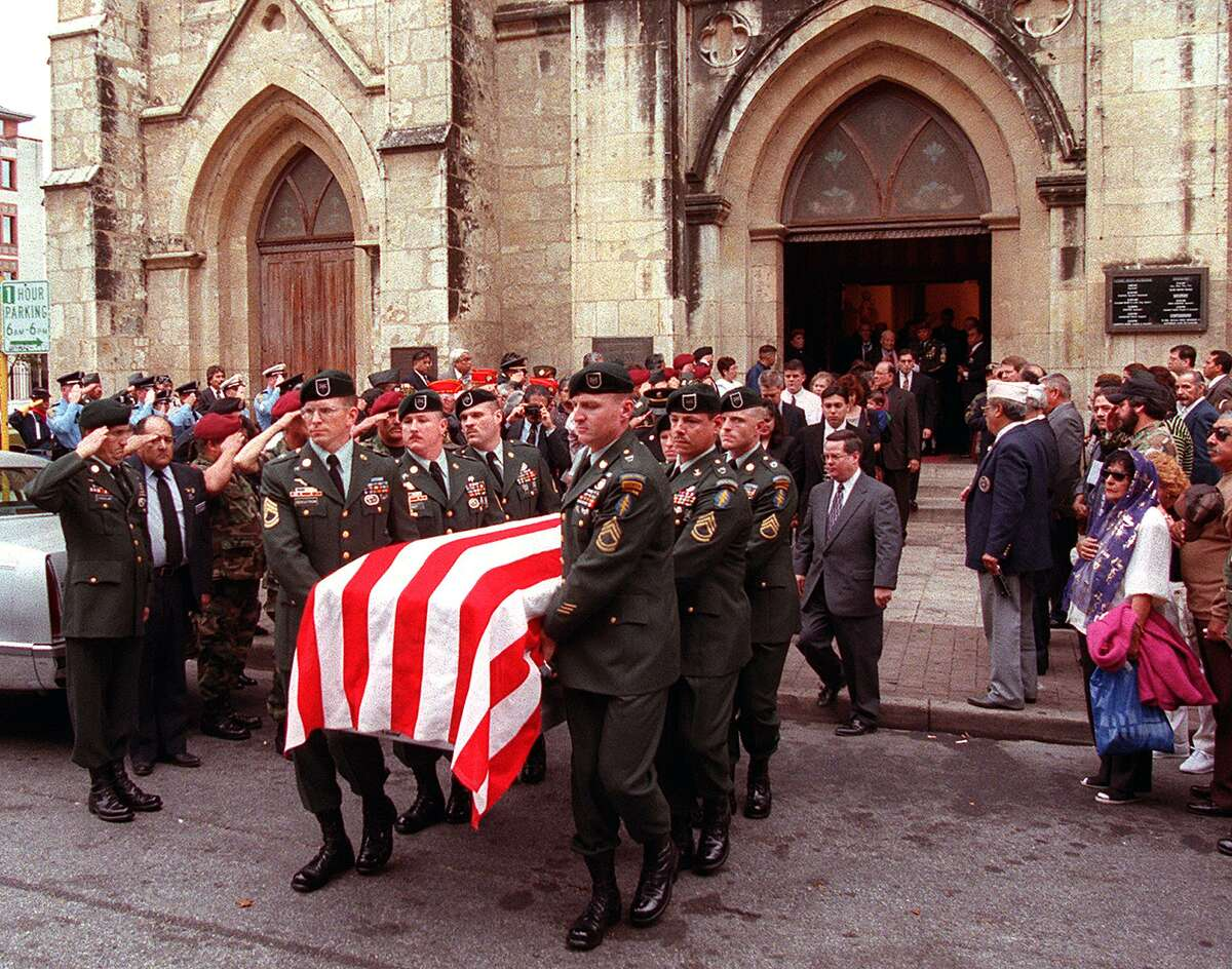 The casket of Medal of Honor recipient Master Sergeant Roy P. Benavidez is carried from San Fernando Cathedral on December 3, 1998, in San Antonio by members of the 5th Special Forces Group, of Fort Campbell, KY.