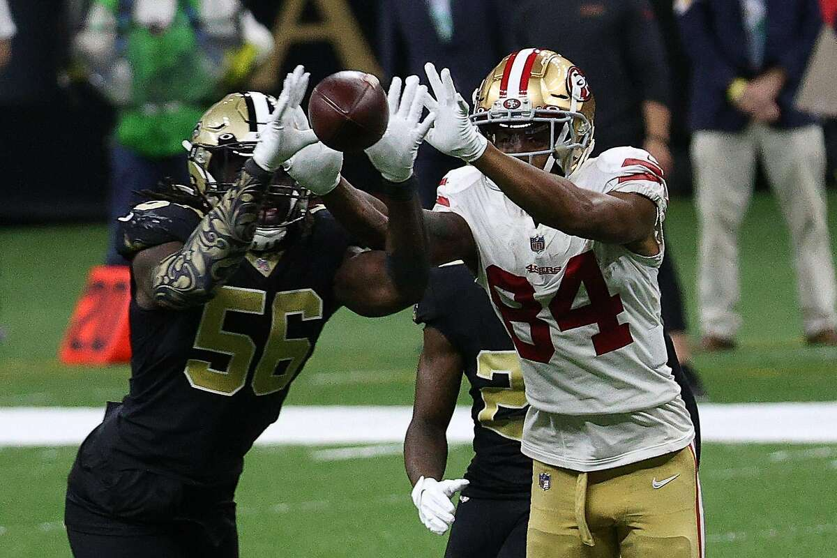 Kendrick Bourne #84 of the San Francisco 49ers and Demario Davis #56 of the New Orleans Saints battle for the ball during their game at Mercedes-Benz Superdome on November 15, 2020 in New Orleans, Louisiana.