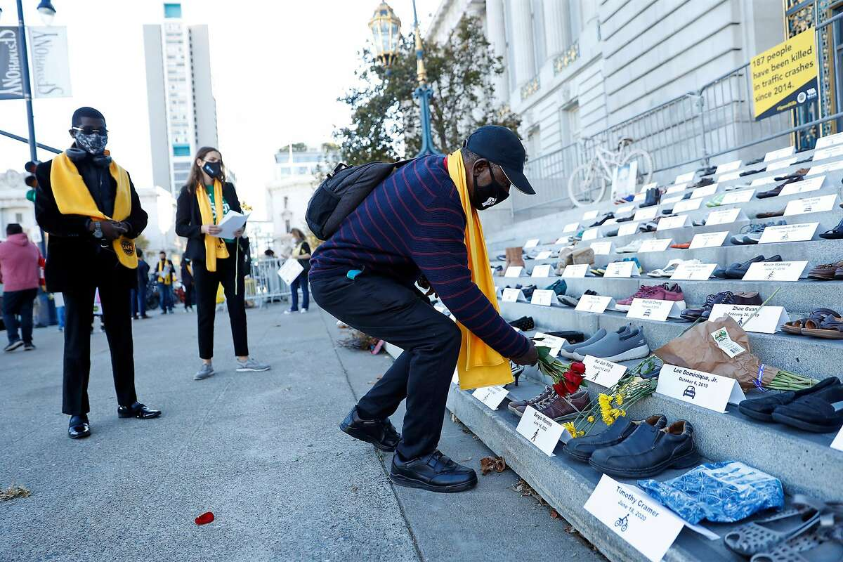 Martial York lays flowers in remembrance of close friend Norman Tanner during World Day of Remembrance for Road Traffic Victims outside San Francisco's City Hall.
