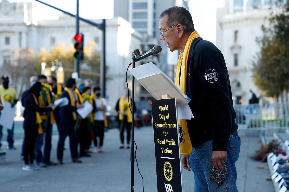 SF Board of Supervisors President and traffic crash survivor Norman Yee reads aloud the names of victims during World Day of Remembrance for Road Traffic Victims at City Hall in San Francisco.