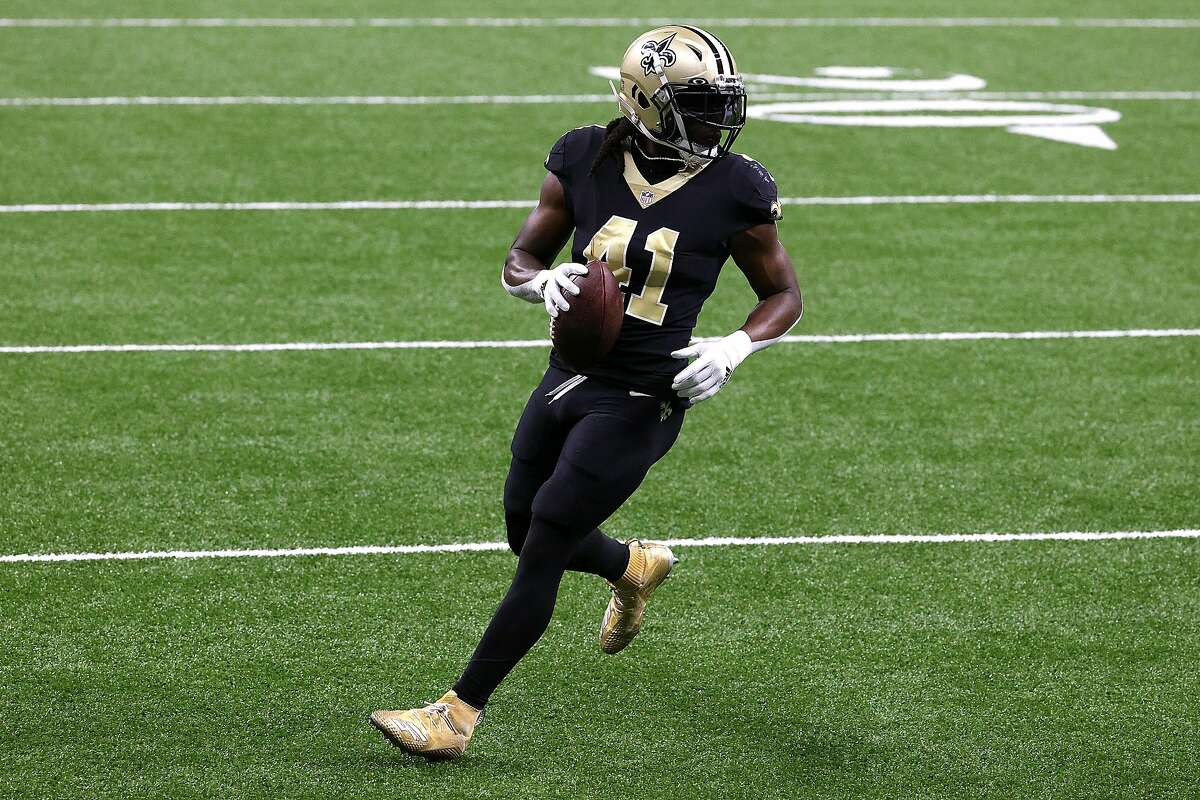 Alvin Kamara #41 of the New Orleans Saints carries the ball in for a touchdown during their game against the San Francisco 49ers at Mercedes-Benz Superdome on November 15, 2020 in New Orleans, Louisiana.