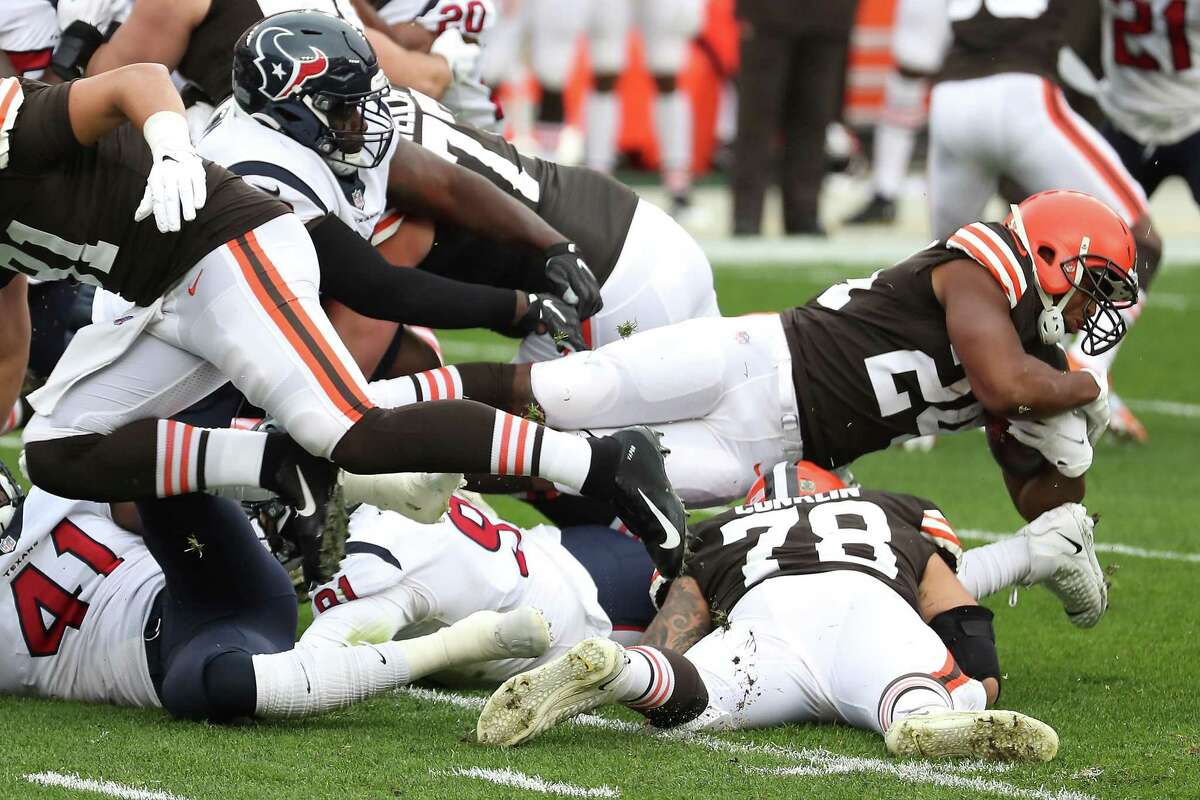 Cleveland Browns running back Nick Chubb (24) dives for extra yardage against the Houston Texans defense during the first half of an NFL football game at FirstEnergy Stadium Sunday, Nov. 15, 2020, in Cleveland.