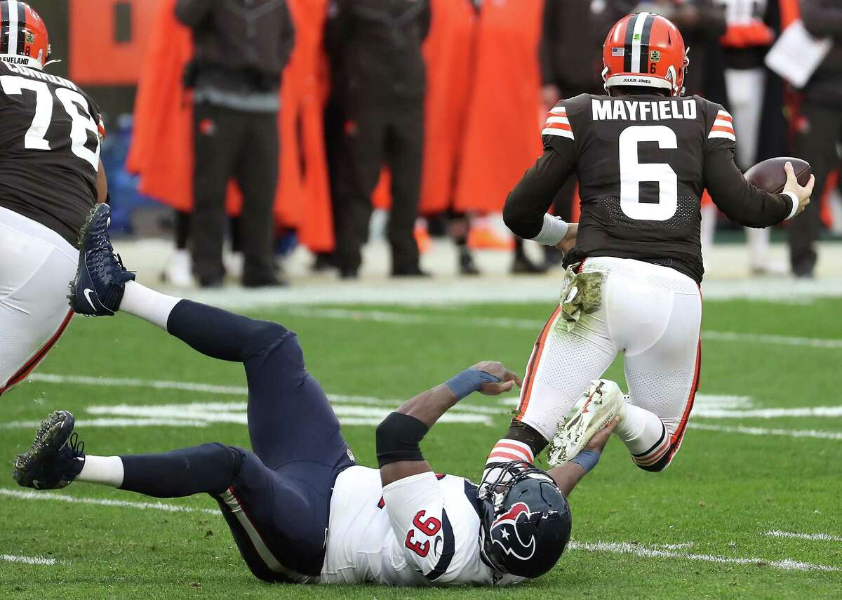 Houston Texans defensive lineman Corey Liuget (93) sacks Cleveland Browns quarterback Baker Mayfield (6) during the third quarter of an NFL football game at FirstEnergy Stadium Sunday, Nov. 15, 2020, in Cleveland.