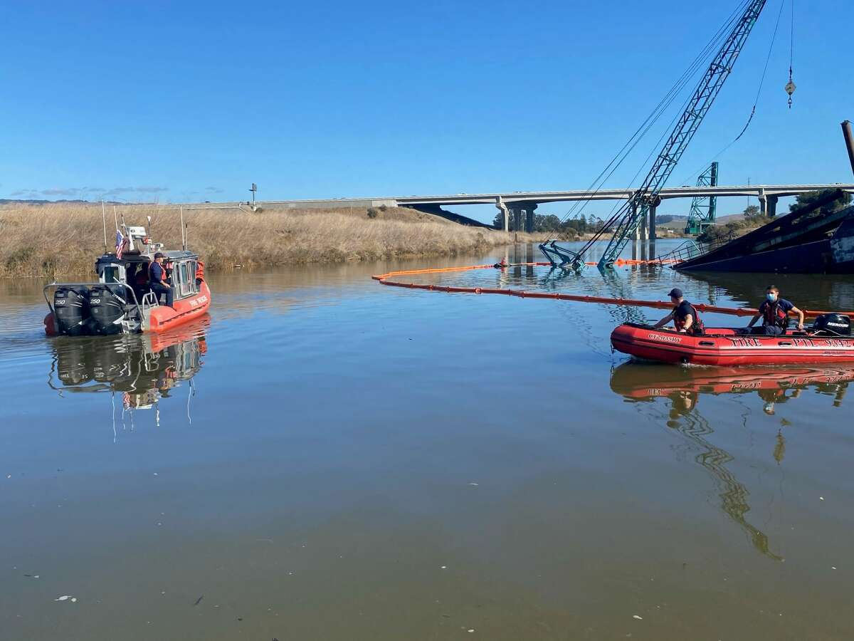 The sinking barge was first reported about 10 a.m. Sunday adjacent to Heritage Salvage about a quarter-mile north of the U.S. Highway 101 overcrossing of the river.