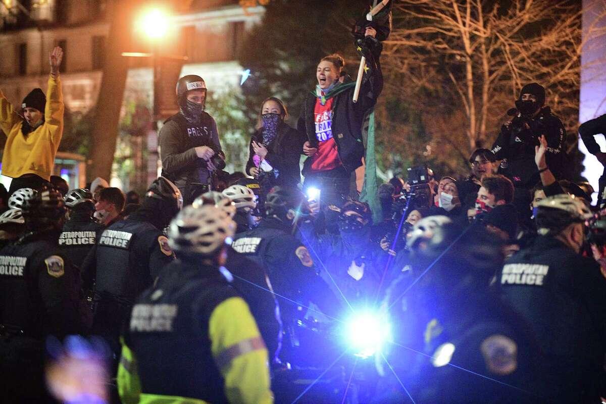 Demonstrators confront D.C. police at Black Lives Matter Plaza in Washington, D.C., on Nov. 14, 2020.