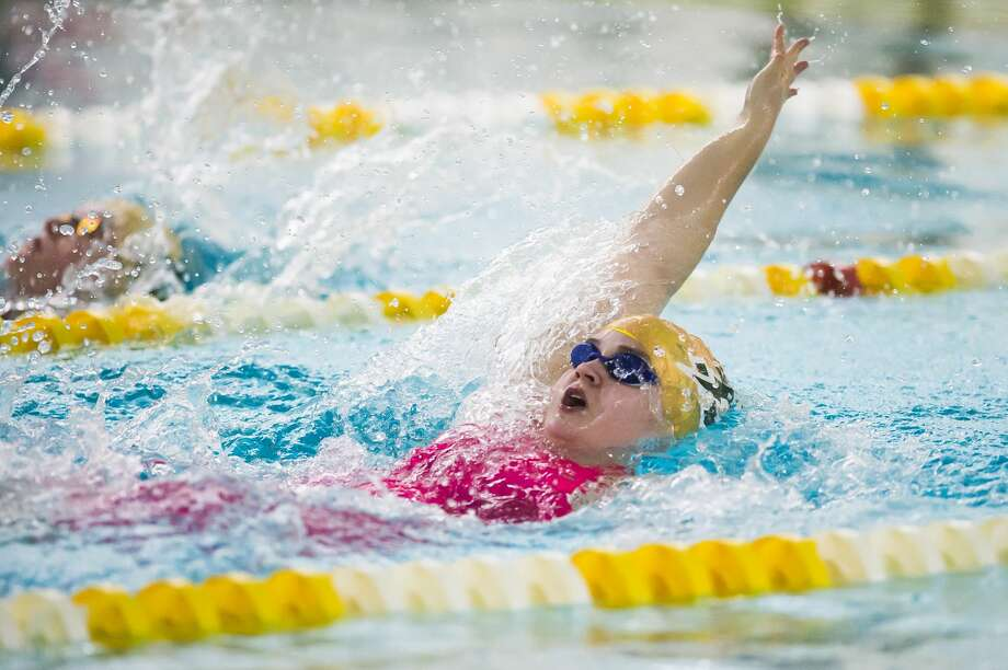 Dow High's Chloe Stafford competes in the 100-yard backstroke during a Nov. 2, 2020 meet against Midland High. Photo: Daily News File Photo