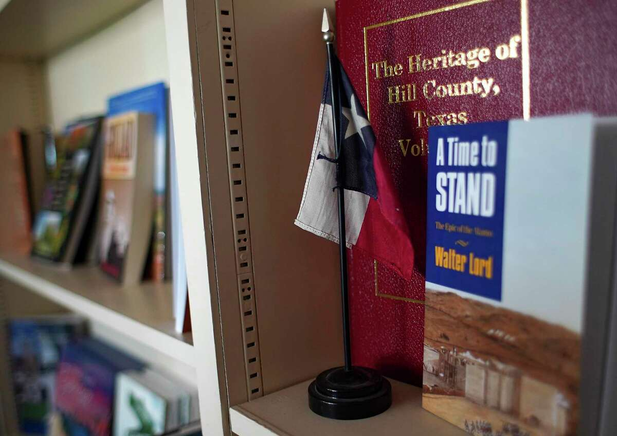 A bookshelf with Texas-themed books at River Oaks Bookstore in Houston on Sunday, Nov. 15, 2020. After nearly forty-seven years, the locally-owned store is scheduled to close at the end of the year.