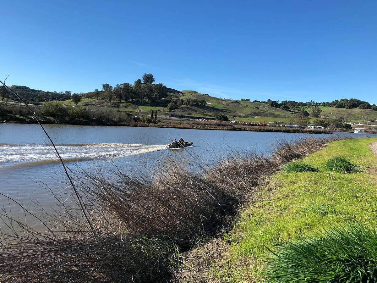 A barge containing petroleum products sank Sunday along the Petaluma River, shown here in 2018.