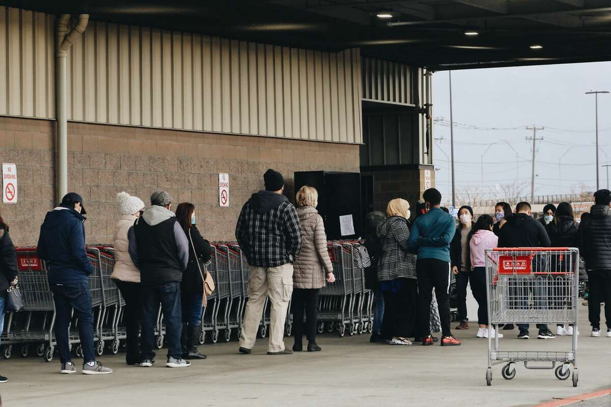 Hundreds of people lined up outside Costco on November 15, 2020 after Gov. Jay Inslee announced new strict COVID-19 restrictions.