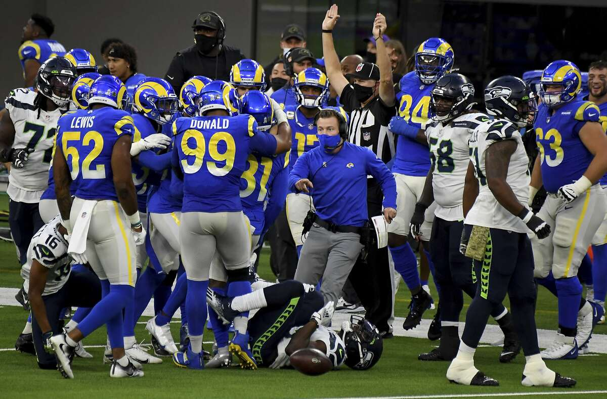 Head coach Sean McVay (center) and the Los Angeles Rams celebrate in the fourth quarter after defensive back Darious Williams (31) makes one of his two pass interceptions in the game.