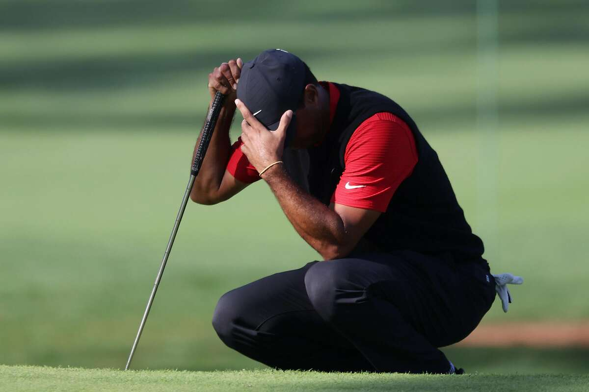 Tiger Woods reacts on No. 7 at Augusta National, which he bogeyed Sunday. He finished with a 76, and tied for 38th place at 1-under for the Masters.