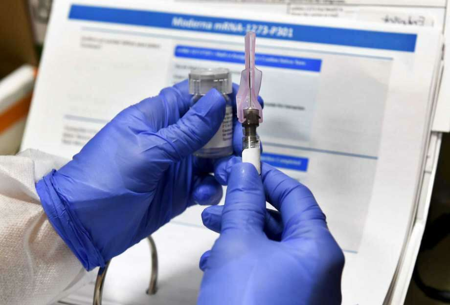 Moderna said Monday, Nov. 16, 2020, in Binghamton, N.Y., its COVID-19 shot provides strong protection against the coronavirus that's surging in the U.S. and around the world. Photo: Photo: Hans Pennink, AP