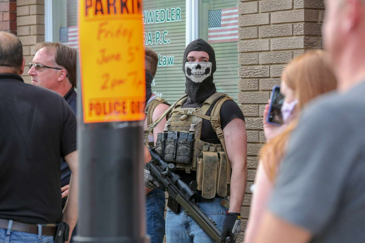 Huron Daily Tribune photos from a Black Lives Matter rally in Bad Axe on Friday, June 5, 2020 include images of men holding weapons among those in attendance.