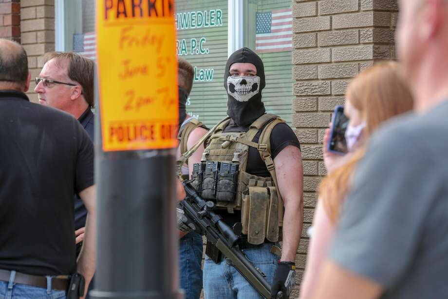Huron Daily Tribune photos from a Black Lives Matter rally in Bad Axe on Friday, June 5, 2020 include images of men holding weapons among those in attendance. Photo: Eric Young/Huron Daily Tribune / © Huron Daily Tribune 2020