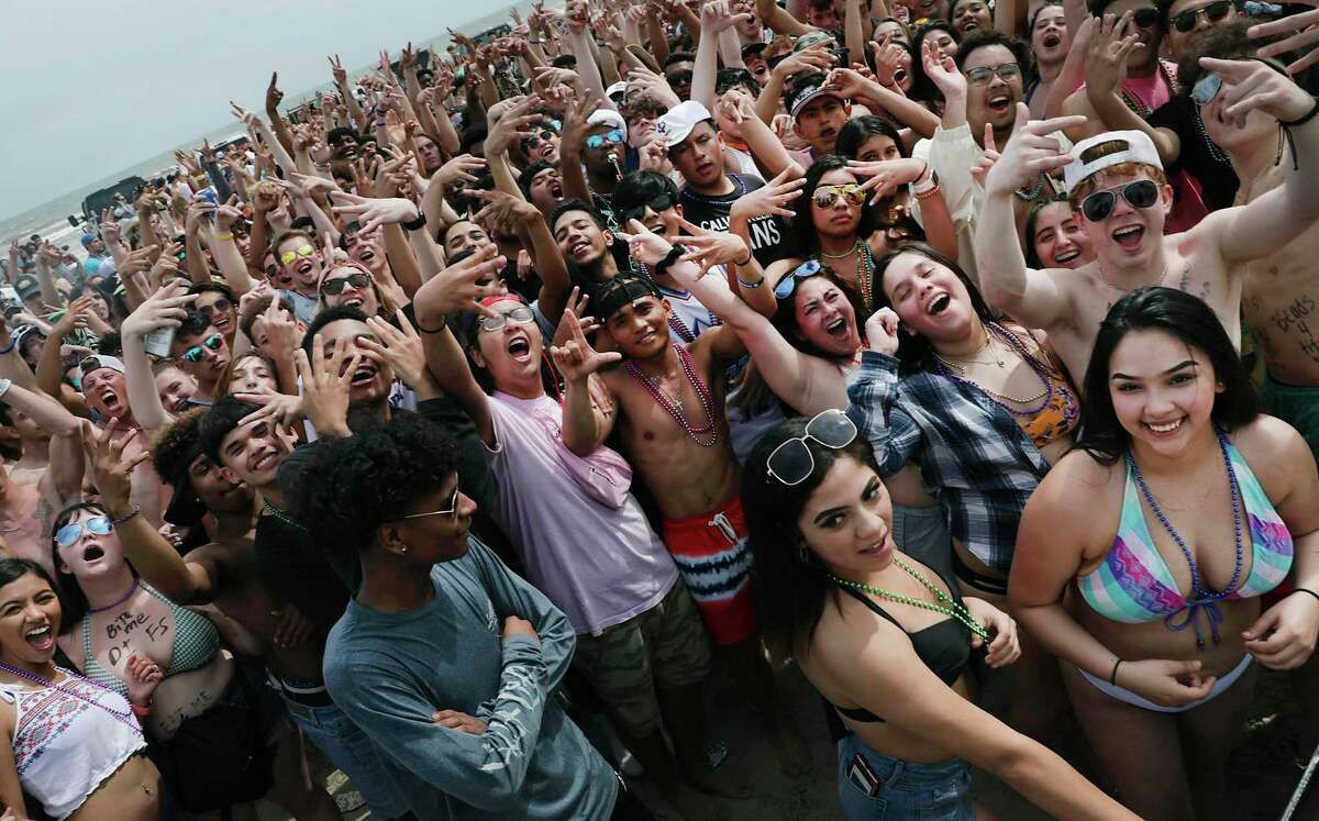 A youthful crowd dances to music by a DJ on the beach at Port Aransas. Spring Break has hit Port Aransas in a big way and it will only get bigger during the coming weekend when University of Texas and Texas State will start their spring break, on March 12, 2020.